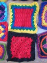 Two red crochet squares