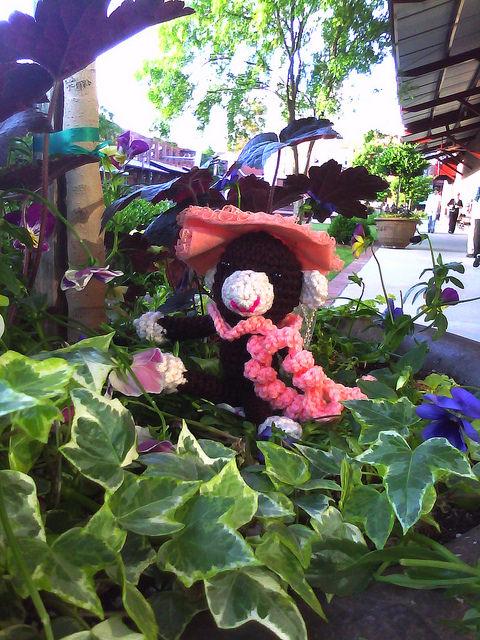 crochet monkey frolicking in flowers