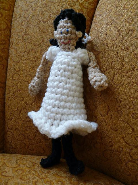 crochet doll on a chair