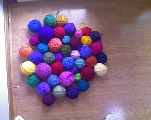 frogged yarn wound into balls