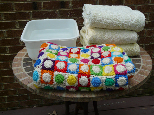 A tub of water, a pile of towels, and crochet project. Let the blocking begin