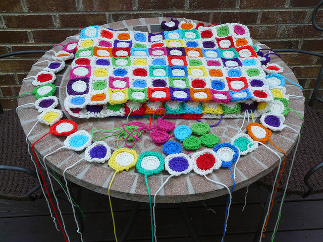 The crochet circles and crochet squares that make up the hilbert curve crochet blanket
