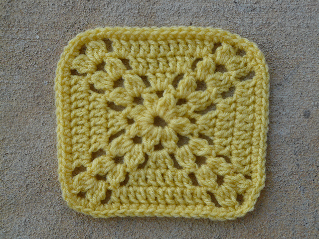 Square 23 crochet granny square worked in yellow yarn