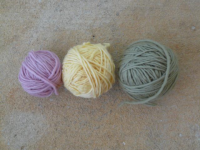 reclaimed wool yarn wound into balls