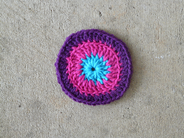 a third round of crochet square 57 worked in purple