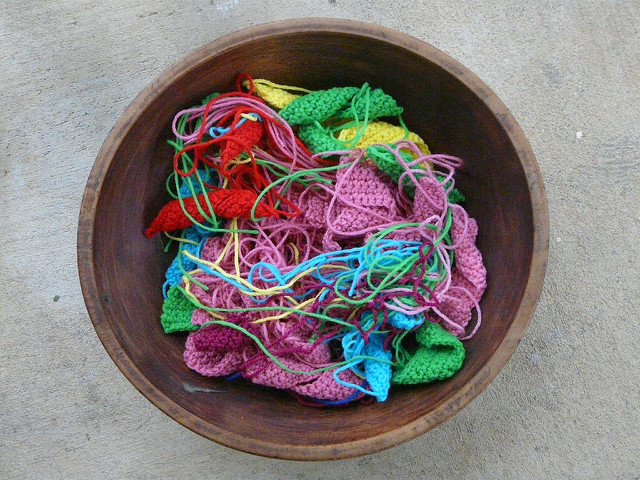 bowlful of crochet squares and crochet rectangles