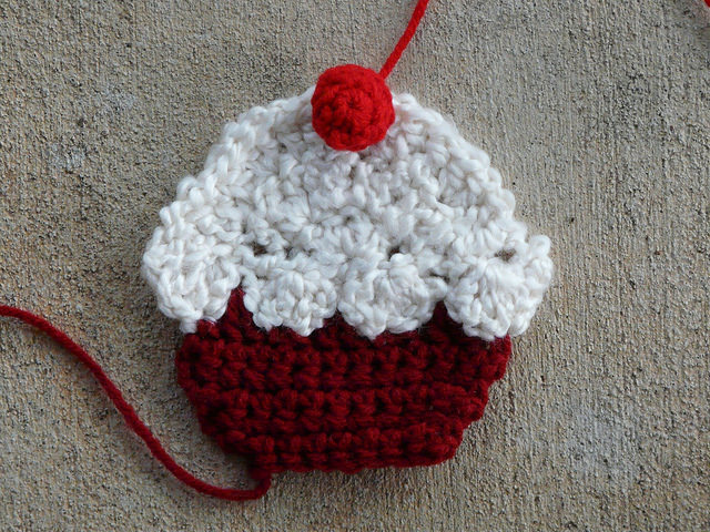 crochet cupcake with a crochet cherry