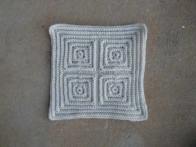 a textured crochet square that resisted my efforts to finish it