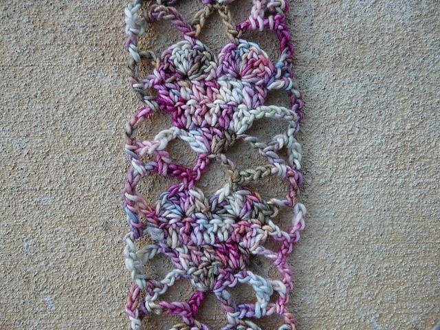 A detail of Alice Merlino's crochet heart scarf