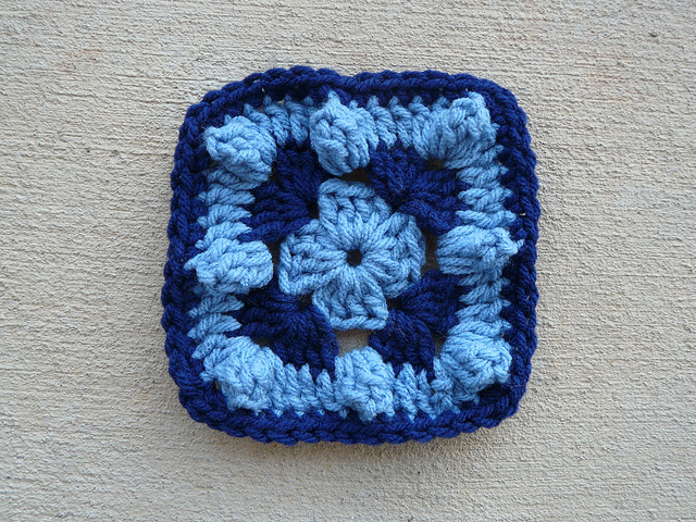 A blue textured crochet square 95