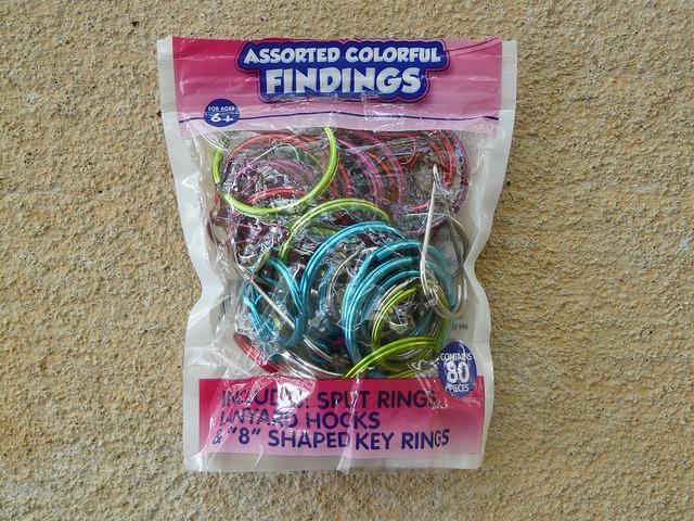 A bag of assorted split rings, lanyard hocks, and figure-8 shaped key rings