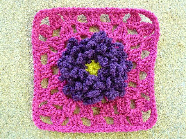 crochet granny square with a crochet flower center