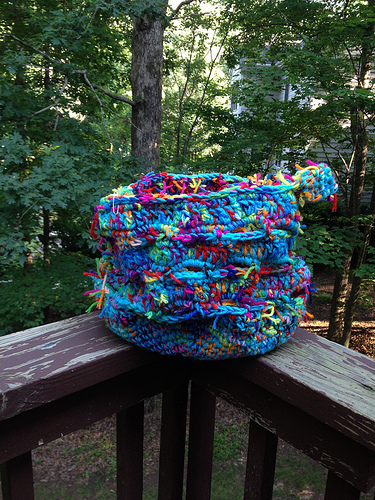 a nearly completed scrap yarn stash basket