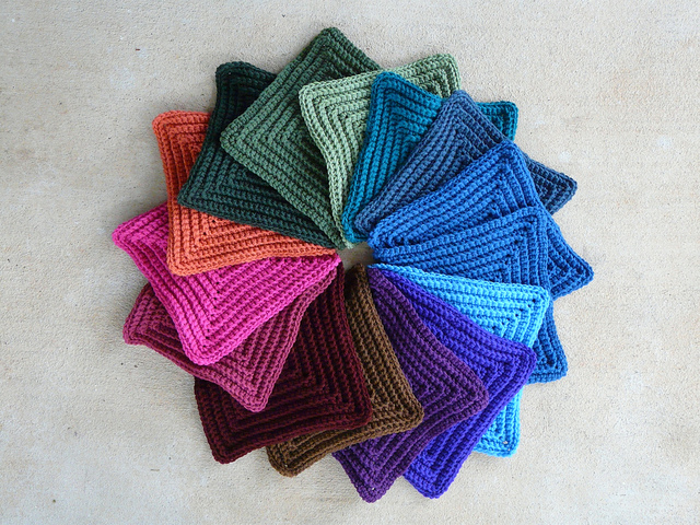 Fifteen large textured crochet squares made on a rainy day