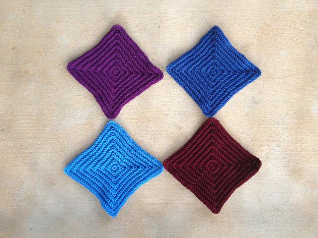 Four large textured crochet squares