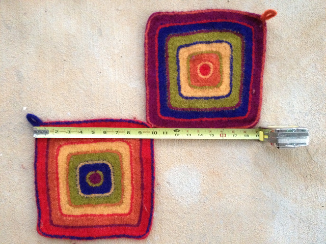 two wool crochet poldholders after felting