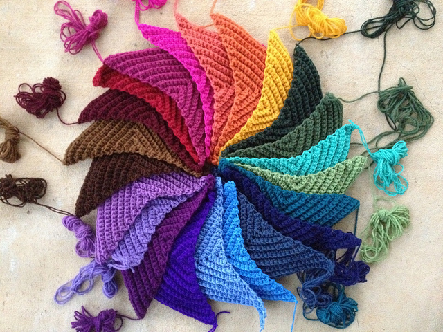 twenty-two textured crochet triangles