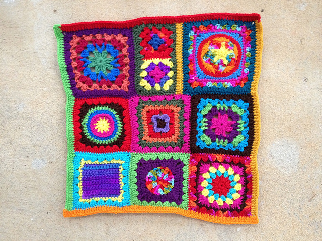panel of a granny square crochet purse