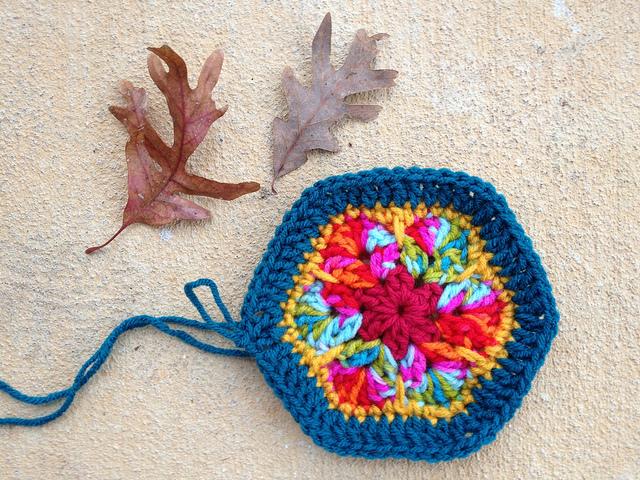 African flower crochet hexagon with a teal border