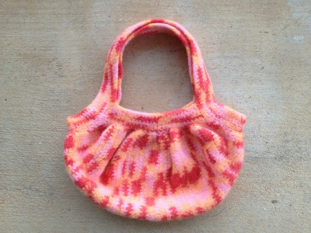 A felted crochet purse made with variegated vintage wool yarn