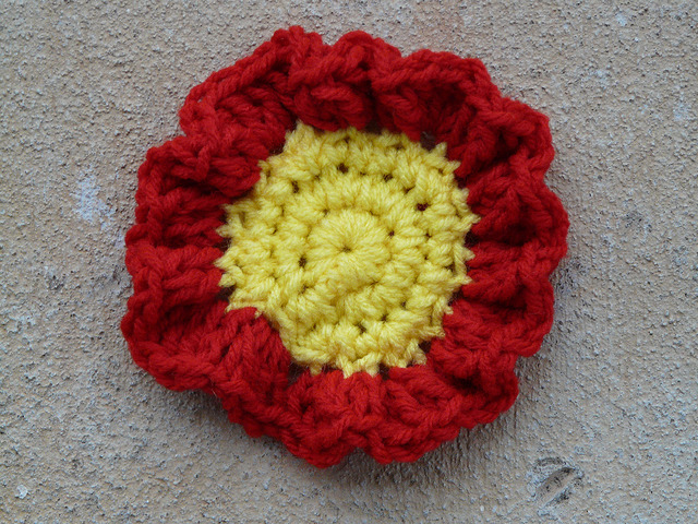 The round and ruffled center of a crochet square