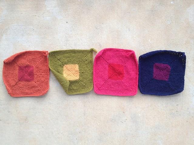four crochet pot holders