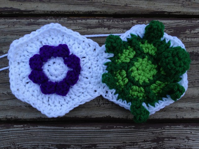 A textured flower crochet hexagon and a crochet turtle hexagon