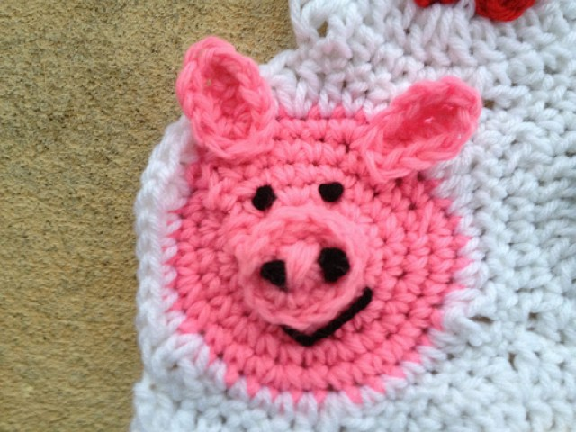 a crochet pig hexagon with crochet ears ready for the ides of February
