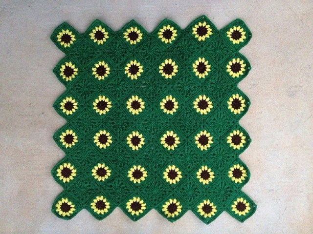 The completed sawtooth sunflower throw shows what a difference a week can make