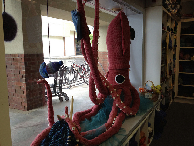 A view of the crochet squid from inside the store inspiring envy