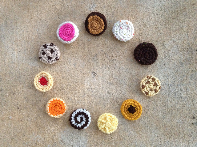 Eleven twelfths of a dozen small crochet cookies, tangible proof of what a difference a week makes
