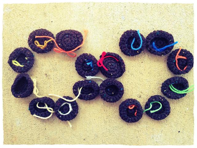 sixteen small crochet cookies