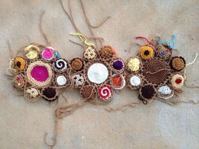 Three crochet cookie motifs of the eleven motifs needed