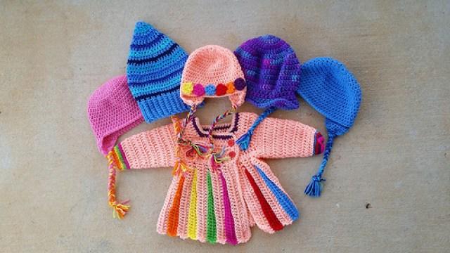 An Eloise crochet sweater and five crochet hats, crochetbug, crochet beanies, crochet flowers, stash buster