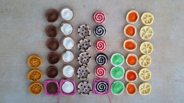 forty-one crochet cookies arranged in a bar graph