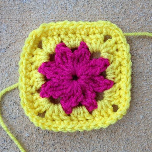 Pink and yellow crochet granny square