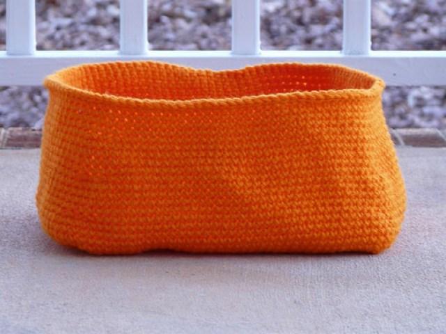 An orange crochet basket