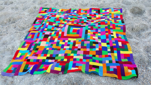 a crochet quilt blanket made from crochet squares and crochet rectangles at Wrightsville Beach