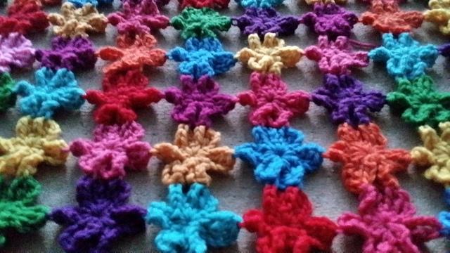 Detail of six petal crochet flower shawl