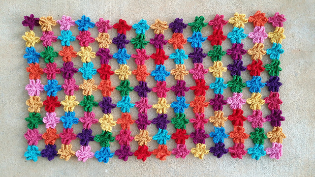 six petal crochet flowers for a multicolor crochet shawl
