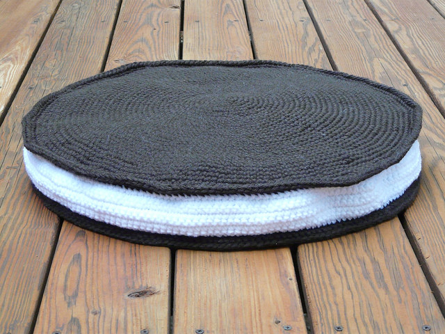 a crochet pet bed that looks like an Oreo cookie for a dog named Oreo