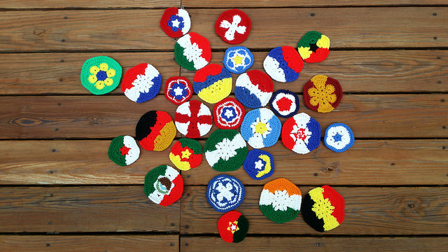 an assomment of crochet pentagons and crochet hexagons for a crochet soccer ball