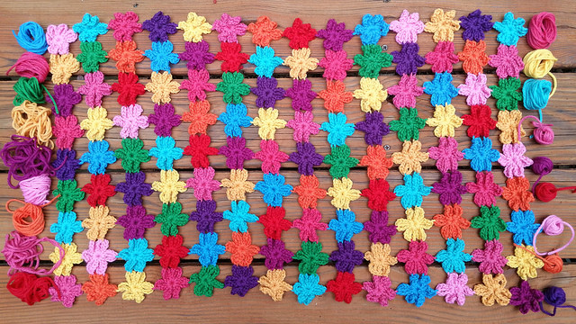 A join as you go crochet flower shawl for a crochet-worthy cousin