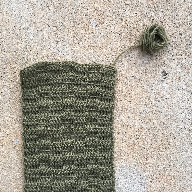 the end of a crochet scarf