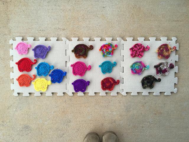 Blocking eighteen crochet elephants