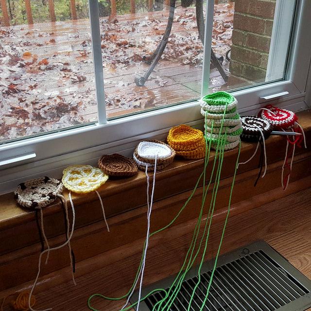 Crochet cookies accrue on a window sill