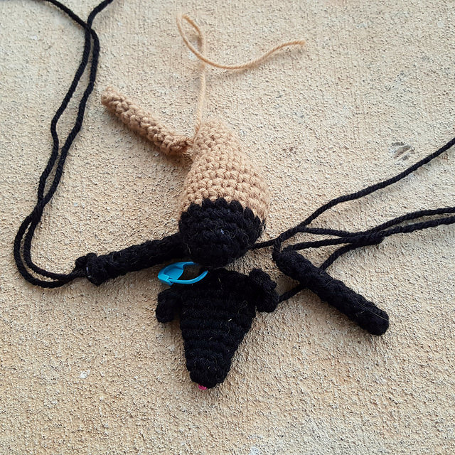 A crochet goat in need of a fourth leg so that it is no longer one of the UFOs/WIPs in my office