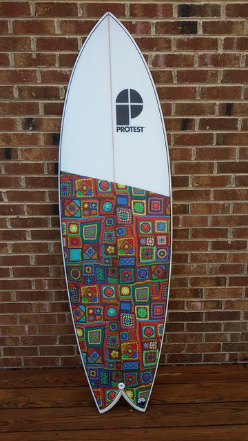 surfboard with crochet graphics