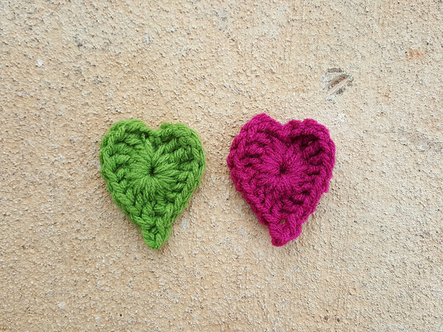 the first round of two boho crochet hearts made as part of a color study