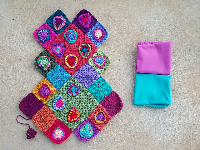 fabric lining for a crochet heart festooned granny square purse